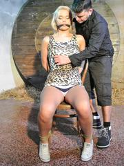 Excited blonde slave Nikky Dream chair-tied leather-gagged