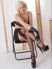 You have to love horny blondes like Vikki wearing sexy lingerie and leather gloves