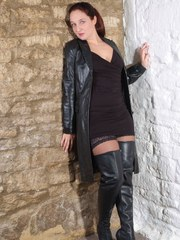 The lovely Sammy B unbuttons her leather coat slowly and just looks so sexy doing