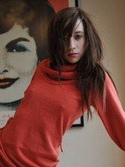Simone deftly strips out of her jeans and sweater for you...enjoy!