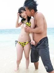 Hina Maeda Asian has clit rubbed and gives fine blowjob on beach