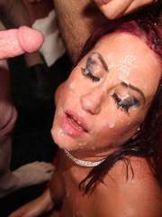 Gorgeous Tyla Moore gets splattered in cum in a sticky bukkake party.