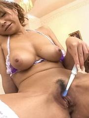 Sumire Matsu Asian fondles tits and puts tooth brush on her twat