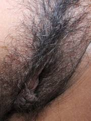 Stunning busty  hairy Thai babe strips to nothingness