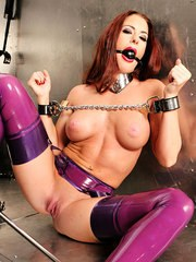 This brunette slut is bound and gagged in a latex dress.