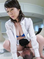 Hitomi Oki exposes hairy cunt and rubs sucked shlong with asshole
