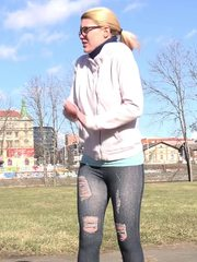 Blonde in glasses squats outside to piss