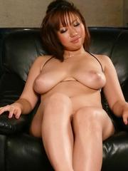 Neiro Suzuka Asian plays with dick between huge cans and gets cum