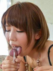 Seira Matsuoka rubs cock with feet in fishnets and licks it well