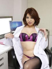 Erika Nishino fucks licks pussy with vibrator and shows her cans