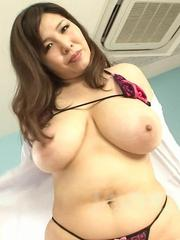 Yume Sazanami Asian takes cock between huge cans and sucks it