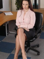 Hot office girl Donna teases in the home office in her silky nylons and beautiful