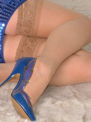 These are some beautiful blue high heel stilettos worn by a horny blonde