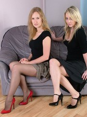 Red heels and black heels worn by two babes