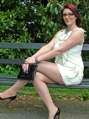 This horny girl loves to pose outdoors in her glasses and high heels