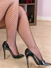 This is one smoking hot blonde wearing some gorgeous stiletto heels