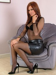 Sexy leather mini skirt covers this girls ass and stilettos cover her feet