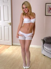 Gorgeous white lingerie and high heels compliment this sexy blonde