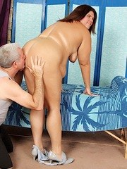Brunette BBW gets her chubby massaged good by a mature man