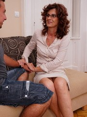 Hairy mature lady having fun with her toy boy