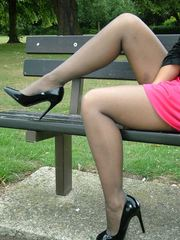 This cheeky blonde babe loves hanging out in public and showing off her heels