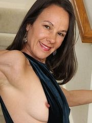 Amateur housewife Sandra Myer strips naked on the staircase.