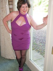 Hi Guys Heres a hot photoset with me in my Sexy Purple Dress seductively stripping