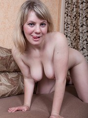 Evlalia is in a beautiful black dress and yellow top and wants to show us her natural