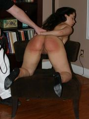 Mackenzie is bidden by Joe to kneel on the chair and present her already well punished