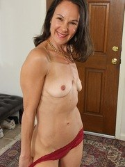 Brunette housewife Sandra Myer sticks her ass in your face.
