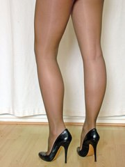 This cheeky blonde looks stunning in black high heels and pantyhose