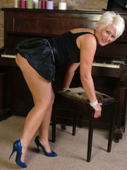 Mature blonde wearing sexy lingerie and a pair of killer blue high heels