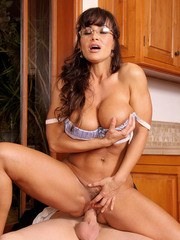 Horny milf Lisa Ann riding cock in the kitchen