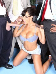 Busty MILF Lisa Ann sucking two white cock and one black cock