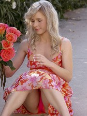 Sweet teen Kara in the garden wearing her classy floral dress and flashing her goodies