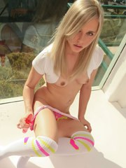 Playful Kara by the window in her cute long socks toying her clit on the floor
