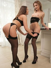 Dressed in thigh high stockings and lingerie that highlights every curve Katy Rose