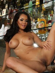 Daisy Marie gets totally nude except for her high heels and then spreads her smooth