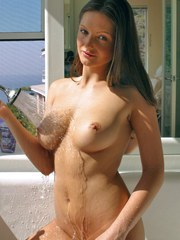 Stunning Sandra in the tub showing her sexy wet body
