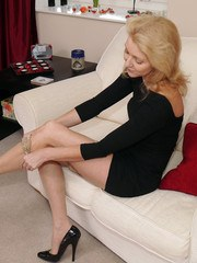 Blonde Milf Magdalena shows off her long legs in a pair of silky nylon stockings