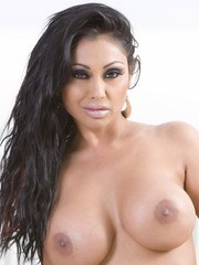 Hot busty Indian Priya Anjali Rai looks amazing in and out of her tight white tank