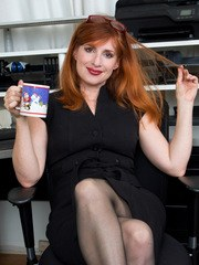 Our favorite redhead milf is back with another round of fun as she gets down and