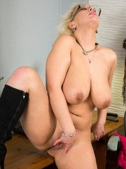 Juicy milf Luba Love stops working to take off her clothes so she can play with her