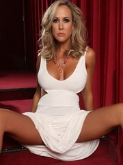 Fit gorgeous Brandi Love strips off her white dress and shows us her ripped up muscles.
