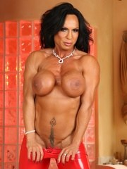 Bigger is better bodybuilder Rhonda Lee strips off her sexy red outfit and flexes