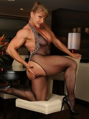 Big bodybuilder Emery Miller strips out of her bodystocking and flexes her huge muscles.