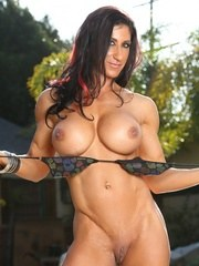 Bodybuilder Elisa Ann models her ripped up body as she strips from her sexy bikini.
