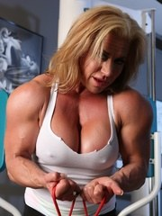 Big strong bodybuiler Wanda Moore works out flexes and strips.
