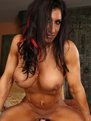 Sexy fit Elisa Ann strips off her red dress flexes her big muscles and has some dildo