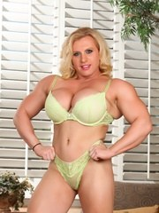 Joanna Thomas loves to dress up in sexy lingerie and show off her strong and powerful